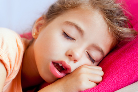 Little girl sleeping with mouth open