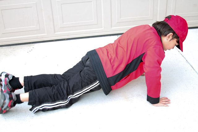 Well Activity and Sport to Keep Teen Health with Push Up in Indoor Room
