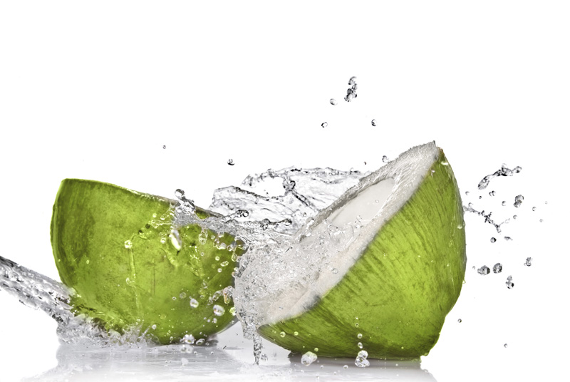 Fresh-Green-Coconut-Divided-into-Two with Pure Water Splash