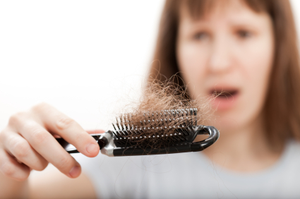 Hair Loss Found on Black Comb by Woman Experiencing Menopause Sign