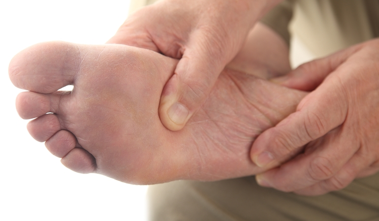 Massaging the lower part of the foot with fingers in pressure