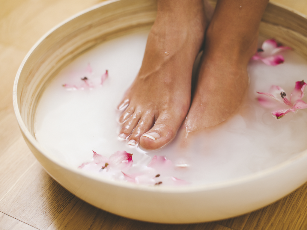 (1) Effective Home Remedies for Calluses on Feet with Beautiful Flowers and White Water in a Bowl